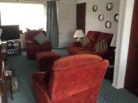 2 reclining Warwick chairs,2 seater Warwick sofa plus foot stool in terracotta