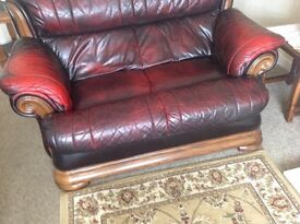 Leather two seater sofa and reclining chair