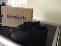 WOMANS black trainers