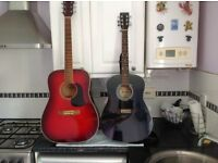 Two Guitars acoustic one ARIA full size adult - one RIKTER junior. Electronic tuner and one strap