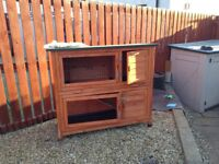 Double level rabbit hutch with weatherproof cover