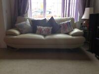 Three seater cream leather sofa £250 cream leather lounger £100