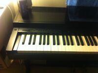 yamaha clavinova CLP-30 digital piano with music stand