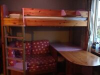 Kids Stompa high sleeper bed. Includes pull-out desk, sofa and shelf. Good condition.