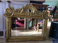 Ornate hand carved wooden guilded mirror