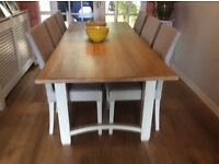 Large modern oak dining table and six chairs, from Ilkley interiors, in excellent condition