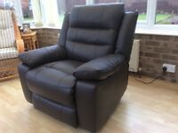 Electric Dark brown leather reclining chair purchased July ...perfect condition
