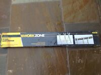 Steel sawhorse perfect for cutting wood with a chainsaw. Brand new still in box.