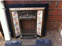 Reproduction Victorian Cast iron tiled fire inset and wooden surround.