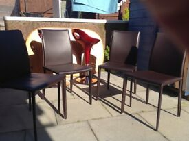 Four brown leather chairs for sale