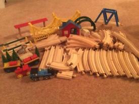Wooden train track like Brio accessories bridges trees station
