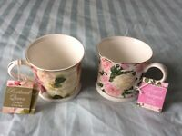 Two brand new fine bone china mugs by Creative Tops. Floral designs.