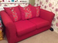 DFS large 2/3 seater sofa and armchair. Red fabric. Excellent condition.
