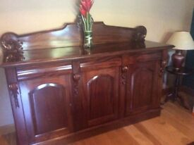 Maghogany dining room table with 6 matching chairs plus matching side board