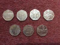 Seven collectible 50p coins.