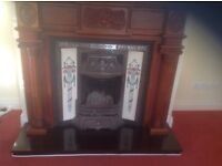 Victorian style mahogany fire surround with tiled cast iron insert