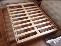 Double bed timber framed with under drawers either side .