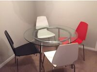 Glass dining table and four chairs for sale