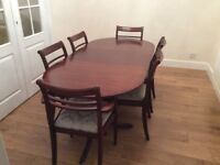 Meredew mahogany table with four dining chairs and two carvers and wall unit with lights