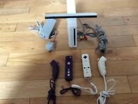 Nintendo Wii with 2 controllers and 2 nunchuks