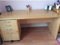 Large, Light wood office desk.