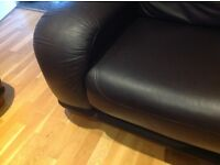 Two chocolate coloured large leather sofas. Very good condition.