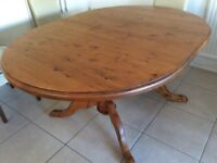 Very solid pine pedestal dining table with two extending leaves