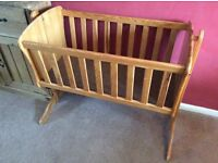 For sale used swinging crib