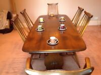 Ercol Dining Table and 6 spindle-back chairs including 2 carvers