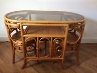 Small glass top cane table and 2 matching chairs