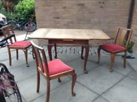 Extendable Wooden table and 3 chairs