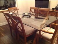 Quality solid wood dining table with tempered glass top and 6 comfortable chairs with matching unit