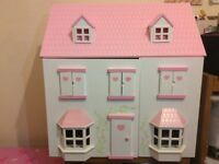 Beautiful wooden dolls house and furniture - Excellent as new. Can deliver