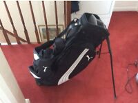 Puma stand bag in fair condition no rips with hood .