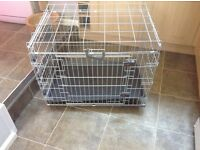 Almost new medium size dog cage with tray