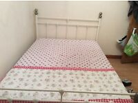 Cream metal double bed frame.