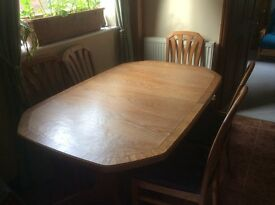 Elm dining table and six chairs