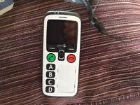 DORO 580secure phone. Emergency button, and information facility. Charging stand and lanyard. In box