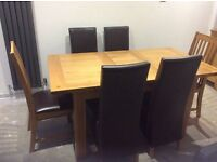 Extending oak table and 6 chairs. SOLD
