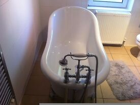 White roll top bath with chrome taps and fittings