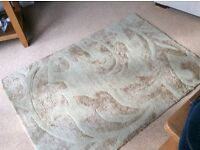 A gold coloured rug in good condition
