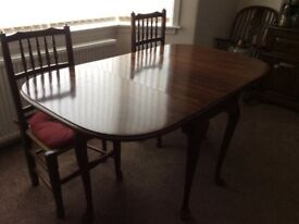 Dining table, mahogany,drop leaves, will seat 8 when fully extended, good condition.