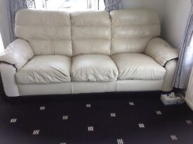 Italian leather three seater sofa and armchair in cream and black