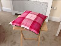Two pink plaid cushions for sale