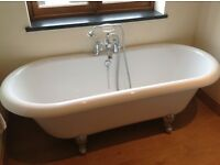 Beautiful Free Standing Bath Tub, including Chrome Mixer Taps and Hand Held Shower.
