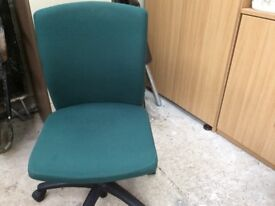 Swivel office chair. Padded and comfortable.