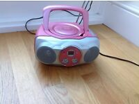 Pink CD player with radio and auxiliary input.
