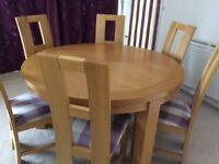 Solid wood round dining room table