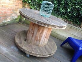 Reclaimed industrial large wooden cable reel on castors - dining room table, patio table