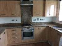 Kitchen with granite worktops and appliances